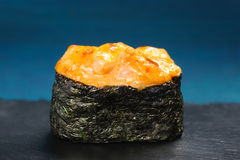 Japan gunkanmaki sushi baked with cheese on blue background Royalty Free Stock Image