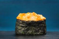 Japan gunkanmaki sushi baked with cheese on blue background Royalty Free Stock Photo