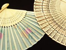 Japan hand fan. Japan wooden fan  with black background Stock Photo