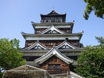 Japan. Hiroshima. The castel. Built in 1589, razed by the bomb, rebuilt in 1958. Two successive enclosures, interspersed with moats, lead to a five-storey fort royalty free stock image