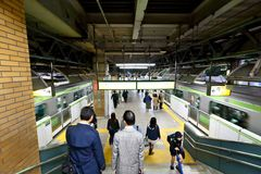 Japan JR station crowd walking down stairs. Crowd walking down stairs toward the train platform at one of JR station Stock Photography