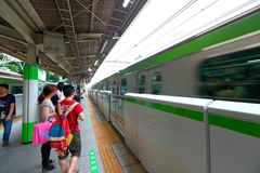 Japan: JR train above ground Royalty Free Stock Images