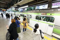 Japan: JR train above ground. Shot taken before boarding JR trains. The Japan Railways Group, more commonly known as JR Group JRグループ Jei stock photography