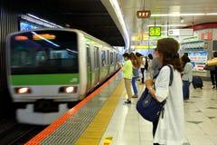 Japan: JR train arriving Royalty Free Stock Image