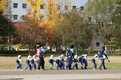 Japan kindergarten trip. OSAKA, JAPAN - NOVEMBER 22, 2016: Kindergarten trip visits Osaka Castle park in Japan. Osaka belongs to 2nd largest metropolitan area of royalty free stock photos