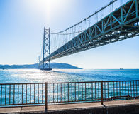 JAPAN,KOBE - 17 JAN 2017. Akashi Kaikyo Bridge, also known as the Pearl Bridge, links the city of Kobe on the mainland of Honshu to Iwaya on Awaji Island Royalty Free Stock Photos