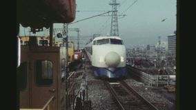 Japanese Speed Train Arrival. JAPAN, KYOTO, APRIL 1978. Japanese High Speed Bullet Train Arrving At The Kyoto Train Station stock video footage