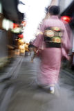 Japan Kyoto Pontocho-dori Woman wearing kimono walking on narrow street motion blur Royalty Free Stock Photos