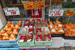 Japan, Kyoto, 04/07/2017. Vegetable counter with price tags in Japanese royalty free stock image