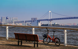 Japan landscape in Tokyo Bay. Rainbow bridge in Tokyo Bay, bench and bicycle scenery Royalty Free Stock Images