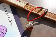 Japan lucky cat and fan. The phrase in Japan - The dance is life stock images
