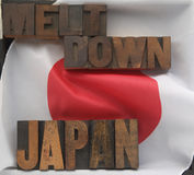 Japan meltdown words. The words Japan and meltdown in old wood type on a Japanese flag Royalty Free Stock Images