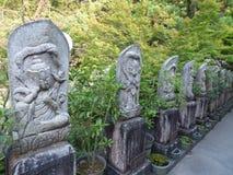 Japan. Miyajima. Daisho-in Temple. Pavillon Daishi-do. Alignment of steles Stock Photos