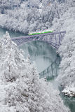 Japan mountain and snow with local train stock photo