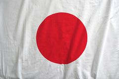 Japan national flag background texture. Fabric texture of the flag of Japan stock images