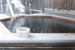 Onsen cover by snow. Japan natural mineral hot spring called onsen cover by snow in Japanese ryokan on the moutain okuhida takayama japan stock photography