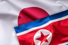 Japan and North Korea flag. Colorful Japan and  North Korea flag. Waving in the wind Stock Photography