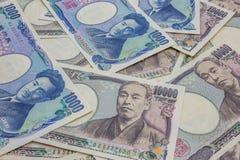 Japan 1.000 och 10.000 yen sedlar Arkivfoton