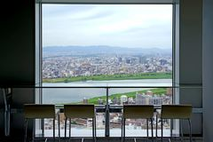 Japan Osaka aerial view from commerical building with silhouette. The Japan Osaka aerial view from commerical building with silhouette of bar table and chairs royalty free stock photos