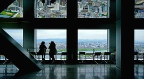 Japan Osaka aerial view from commerical building with two silhouette women. The Japan Osaka aerial view from commerical building with two silhouette women stock images