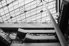 Japan, Osaka - Looking up at the modern view of a tall building. Modern architecture. (black and white) Royalty Free Stock Photos