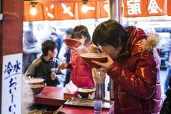 Japan - Osaka - street food near Dotonbori Street. Restaurant stock image