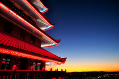 Japan Pagoda. A view of a Chinese pagoda at dusk with the sunsetting over a city in the background Stock Image