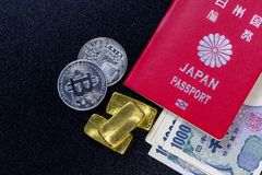 Japan passport with some 1,000 yen banknotes into japanese currency gold bars and bitcoin stock photos