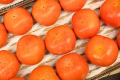 Kaki fruit, Japan. Japan persimmon fruit at a market in Kyoto. Persimmon (kaki) fruit are especially celebrated in autumn Stock Image