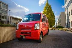 Japan postar leveransbilen Arkivbild