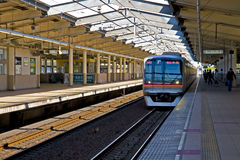 Japan railway train platform. Japan railway station,train and passenger on the platform Royalty Free Stock Photos