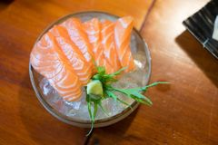 Japan raw salmon slice or salmon sashimi. In Japanese style fresh serve on ice in Japanese restaurant Royalty Free Stock Photography
