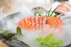 Japan raw salmon slice or salmon sashimi in Japanese style fresh. Serve on ice in Japanese restaurant Royalty Free Stock Photography