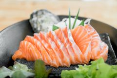 Japan raw salmon slice or salmon sashimi in Japanese style fresh. Serve on ice in Japanese restaurant Stock Photos