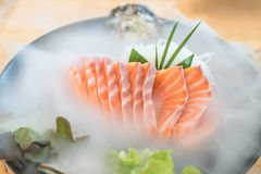 Japan raw salmon slice or salmon sashimi in Japanese style fresh. Serve on ice in Japanese restaurant Stock Photo