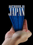 Japan rebuild text. Illustration of hand holding tower of text reading Rebuild Japan Stock Photography