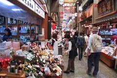 Japan retail. KYOTO, JAPAN - APRIL 19, 2012: Visitors shop at Nishiki market in Kyoto, Japan. Retail market in Japan amounted to 832.6 billion in 2011 stock photo