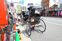 Japan : Rickshaw service with tourist at Asakusa. The picture shows rickshaw parked and ready to pick up customer around Asakusa district . Tourists are enjoying Royalty Free Stock Image
