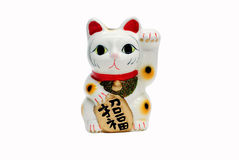 Japan's Beckoning Cat. On white background royalty free stock photos