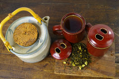 Japan's teapot and cups with green tea on wooden plank Stock Photography