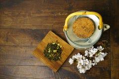 Japan's teapot with green tea and sakura flowers Royalty Free Stock Photography