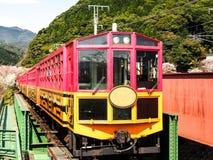 Japan scenic train, Kyoto, Japan 3. Japan scenic train with sakura blossom at Arashiyama, Kyoto, Japan Stock Image