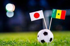 Japan - Senegal, Group H, Sunday, 24. June, Football, World Cup, Russia 2018, National Flags on green grass, white football ball. On ground stock image