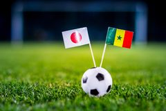 Japan - Senegal, Group H, Sunday, 24. June, Football, World Cup, Russia 2018, National Flags on green grass, white football ball o stock photography