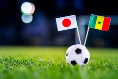 Japan - Senegal, Group H, Sunday, 24. June, Football, World Cup, Russia 2018, National Flags on green grass, white football ball o royalty free stock image