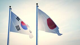 Japan and South Korea flags on a pole show cooperation between Seoul and Tokyo
