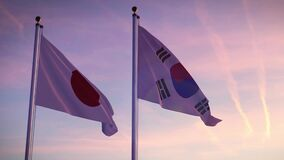 Japan and South Korea flags on a pole showing cooperation between Seoul and Tokyo