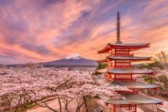 Japan in Spring Season. Fujiyoshida, Japan view of Mt. Fuji and pagoda in spring season stock photos
