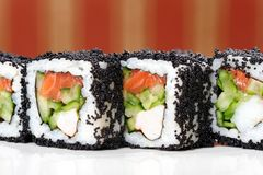 Japan square black tobiko rolls with shrimp, salmon and cucumber Stock Photography