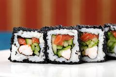 Japan square black tobiko rolls with shrimp, salmon and cucumber Royalty Free Stock Images